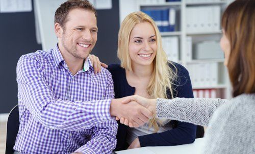 Couple in consultation with the property expert