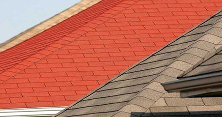 A newly installed roof with red roof tiles