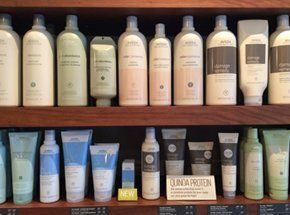 close up shelf with hair and beauty products
