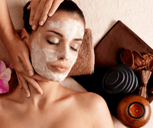 female model having facial skin treatment and massage