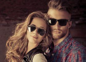 male and female models wearing sunglasses