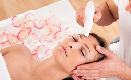 specialist skin treatment with female client