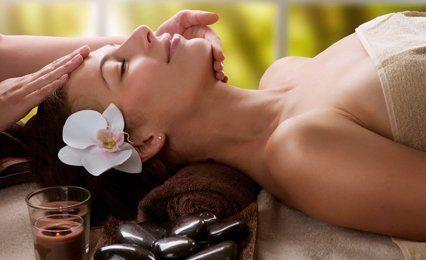 female client having head massage