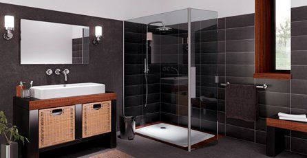 A black shower room with white washbasin