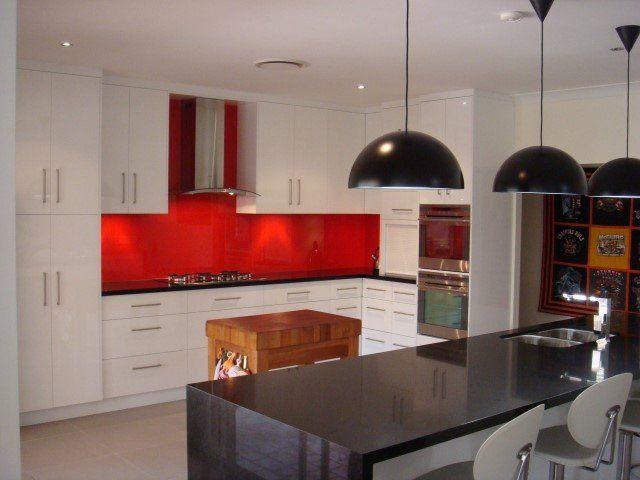black counter top with red blacksplash