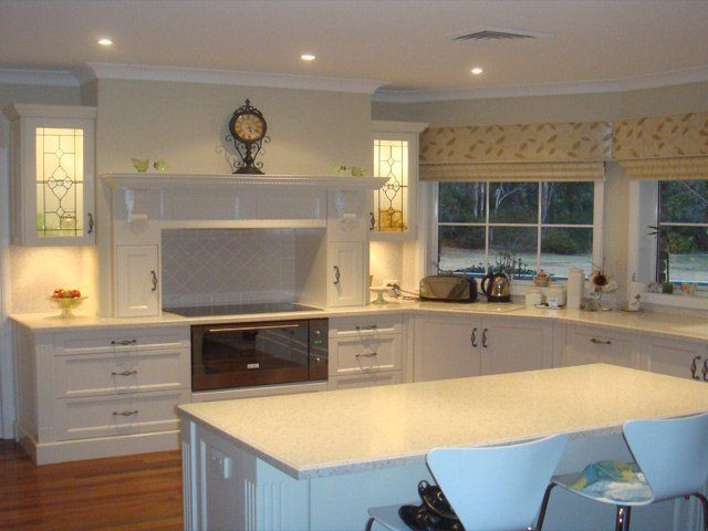 brown wood counter top and white cabinets