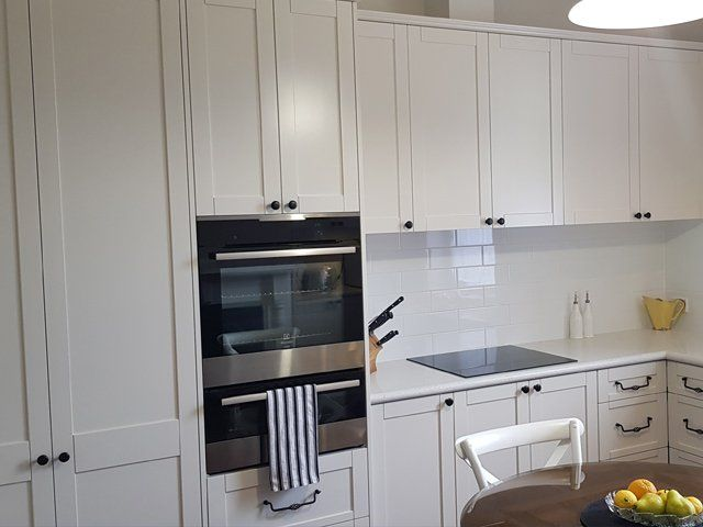 white cabinets and glass covered doors