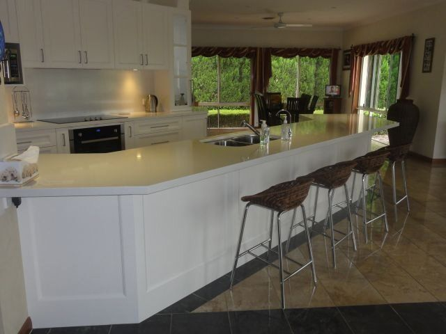 white countertop island with modern chairs