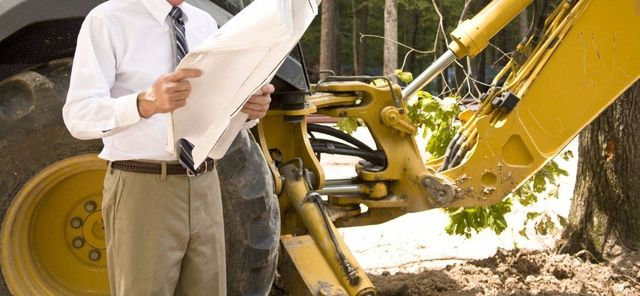 Contractor of earthmoving machinery with the plans in Wellington