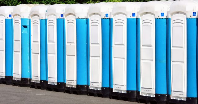 A line of blue and white portable toilets