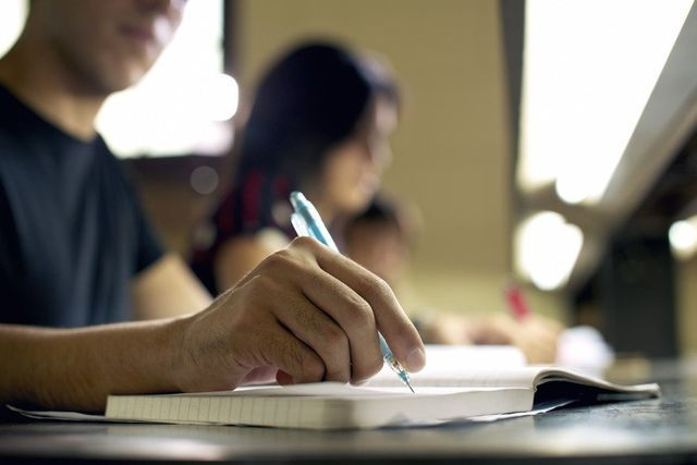 Individual taking notes