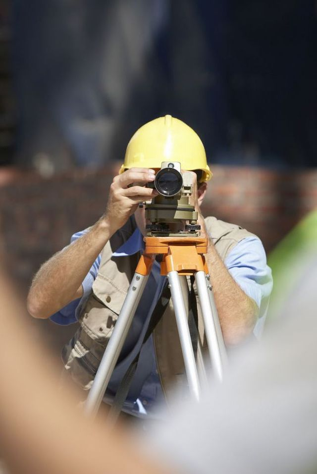 Expert performing surveying services in Southland