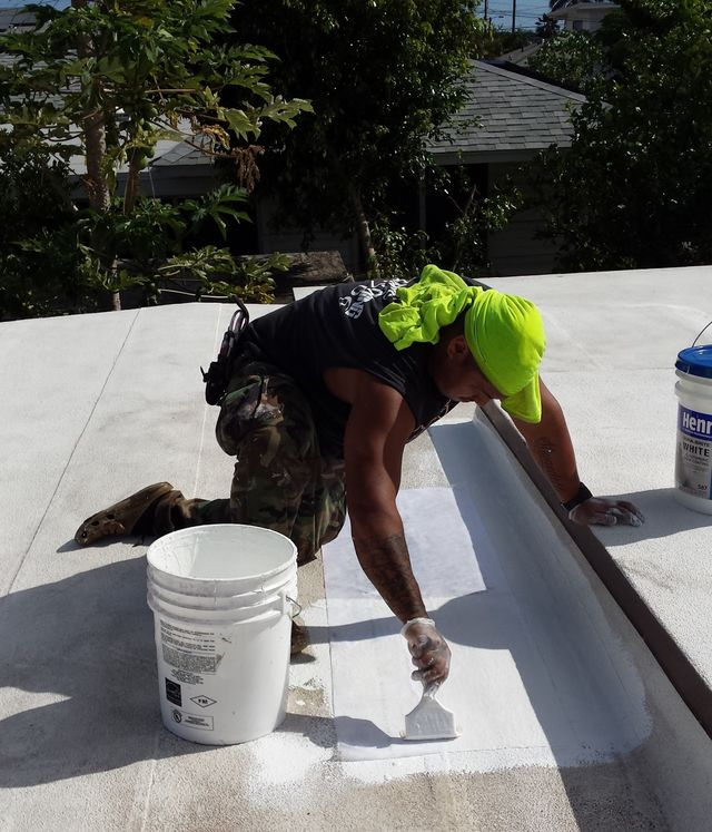 Applying a Cool Roof Coating to a residence in Kaneohe, HI