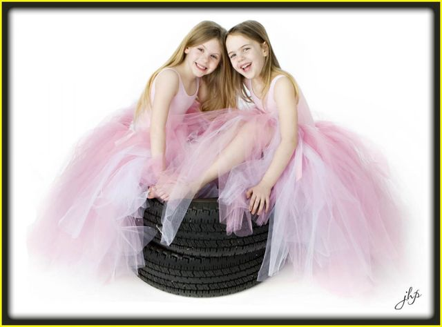 Two girls and two car wheels
