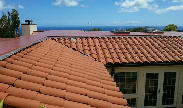 Red roof tiles professionally installed by On Top Roofing