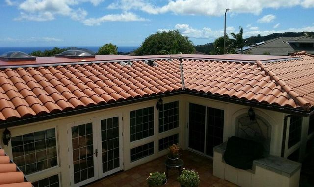 Red roof tiles installed by On Top Roofing