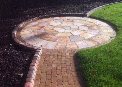 Multi coloured stone paving circle