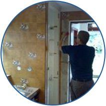 man fitting door