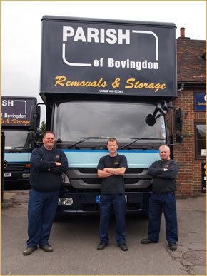 Our removal team stood in front of one of our company vans