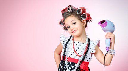 child using a hairdryer