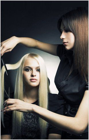 Lady cutting another lady's hair
