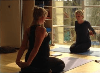 2 ladies practicing yoga