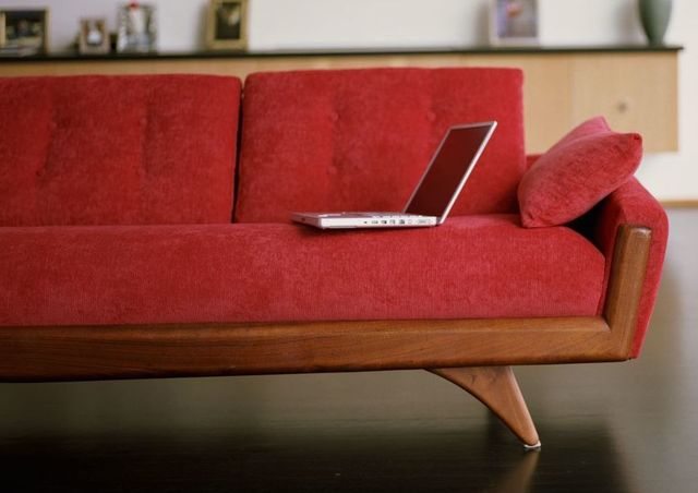 Computer on sofa to contact Upholstery in Wellington