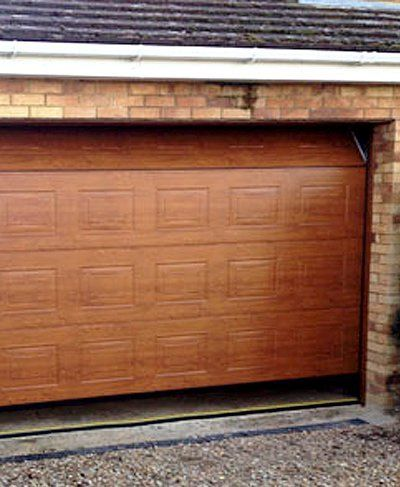 Space saving sectional garage doors fitted in bedfordshire for Premier garage doors