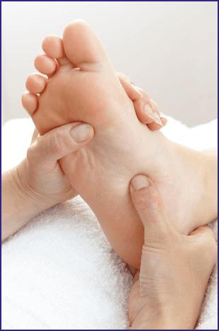 Foot being massaged