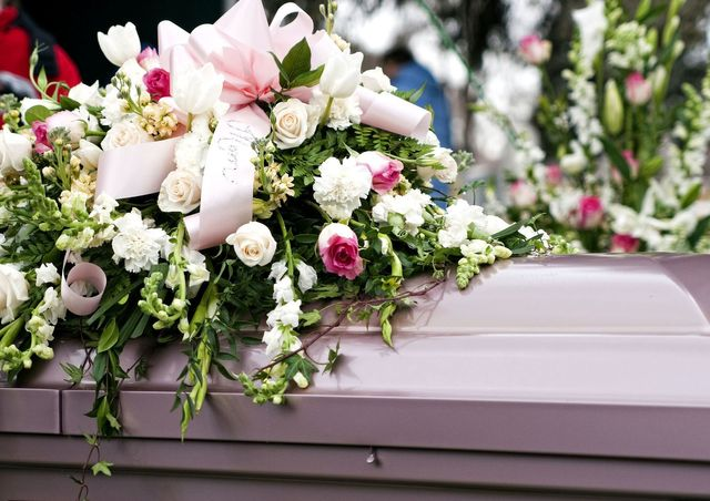 What do families do with flowers after the funeral?