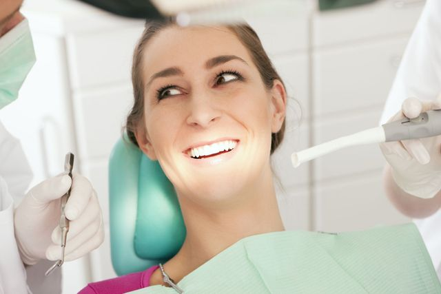 two dentists helping a patient in Tauranga