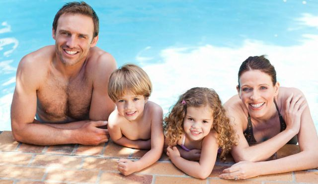 A family that is happy with their swimming pool designs in Cleveland, NC