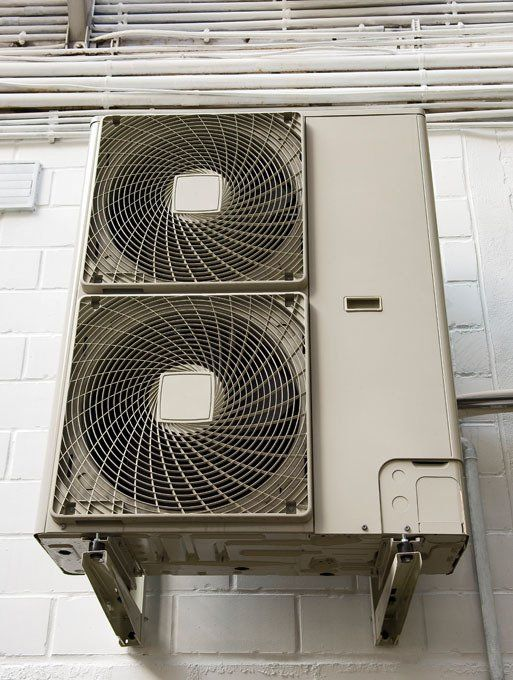 Large commercial cooling fans on a wall