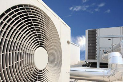A large industrial fan on a roof
