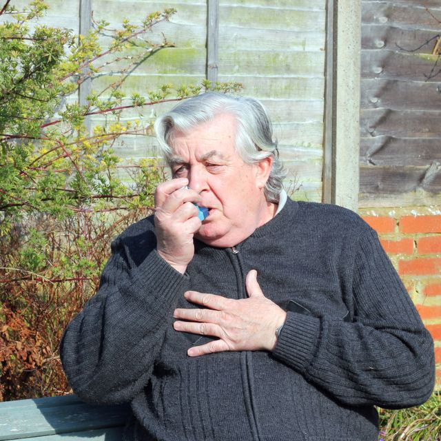 Elderly man having issues with asthma