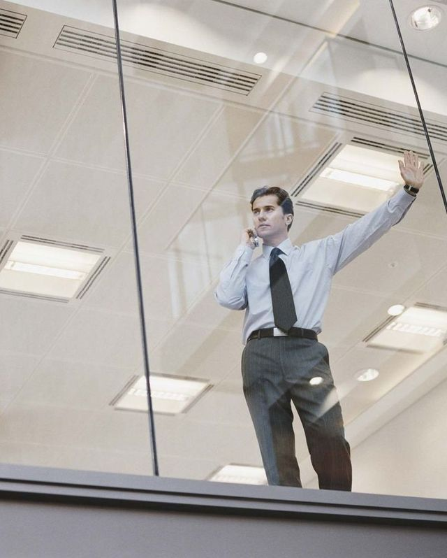 Man leaning against glass window