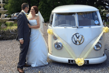 a couple next to VW van