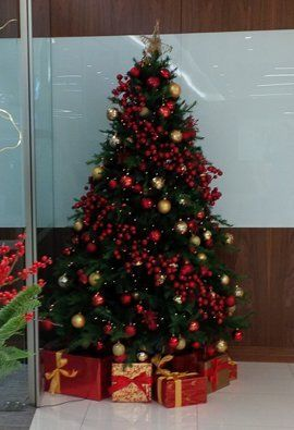 a christmas tree with red decorations - Christmas Decorations For Businesses