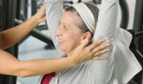 Woman is doing beneficial exercises at a chiropractic center in Lexington, KY