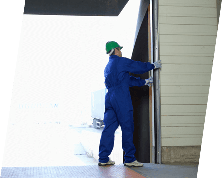 A workman looking at the frame of an industrial door