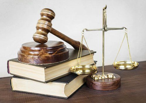 Law books, gavel and scale