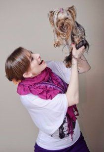 owner holding up Yorkshire Terrier