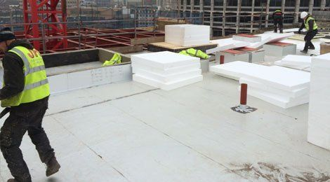 Our team working on a commercial flat roofing project