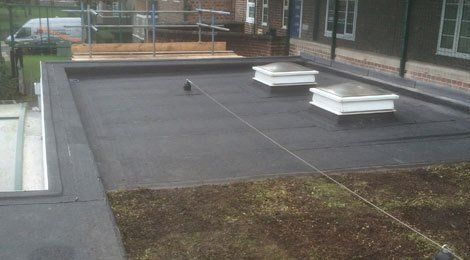 A partially completed flat roofing project