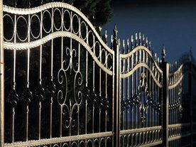A wrought iron gate with a wavy design