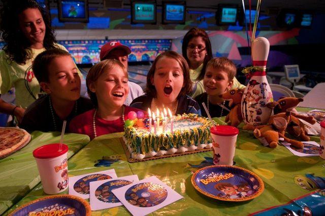 kid with birthday cake