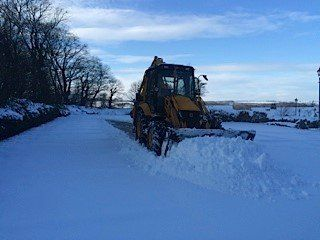 A digger at work on snow clearance