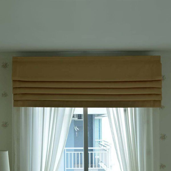 blackout blinds folded at the top of a bedroom window