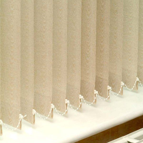 row of beige vertical blinds with beading attached