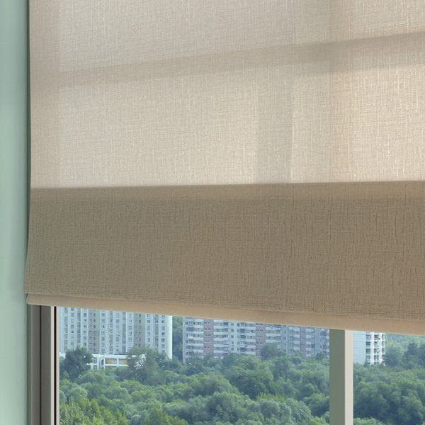 roller blind half drawn over a high-rise window
